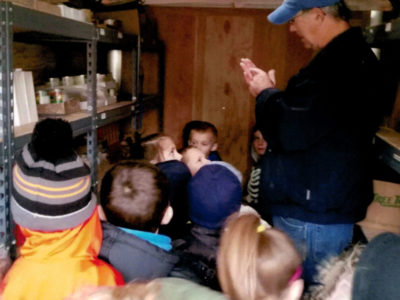 kids touring food bank trailer